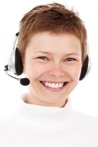 smiling-phone-operator free stock photo